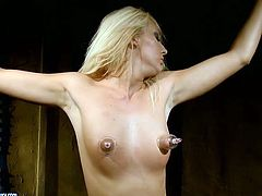Slutty blond hoe gets crucified with her hands hanged to the ceiling before an insatiable black master extends her small tits and shaved vagina with vacuum in peppering BDSM-styled sex video by 21 Sextury.