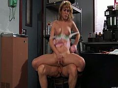 This blonde babe with big natural tits and a trimmed pussy rides a guy on a chair reverse cowgirl style. She puts her panties aside and keeps riding him hard.