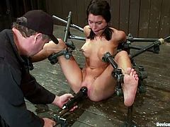 Sexy girl sits on the floor with her legs wide opened being bonded. After that she gets fucked with a fucking machine.