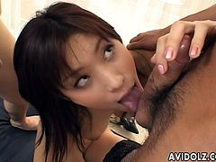 Sweet Asian hottie Ricko Tachibana likes to be licked and these two horny dudes even lick her armpits which turns her on so much she happily gives them both a blowjob.