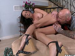 Big tittied Brandy Aniston gives a titjob and gets nailed