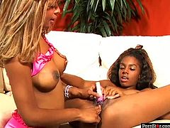 Exotic looking naive Ebony amateur gets her bald unused vagina tickled with vibrator before another doxy stands in doggy position to welcome a tongue fuck from her.