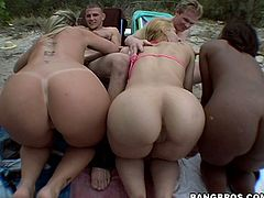 Ruby, Sara Jay and their GF are playing dirty games with two dudes on a beach. They show their big asses to the men and then admire them with their cock-sucking abilities.