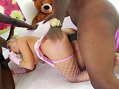 Adorable blonde beauty Andi Anderson with huge juicy gazongas in fishnet stockings gets sweet ass drilled in rough interracial threesome with black studs Ice Cold and Rico Strong with monster cocks.