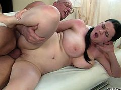 Bosomy brunette amateur makes out with insatiable grey-haired grandpa. She rides him reverse before he takes her from behind in sideways pose in peppering sex video by 21 Sextury.
