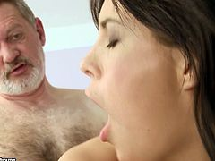 Mouth-watering brunette sexpot is riding hard stick of horny old grandpa. Then she bends over the couch lifting her ass up in the air. She gets banged bad doggy style.