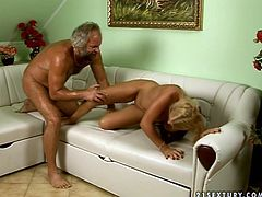 Luscious blonde chick with ponytails experiences sex with old man first time. She stands on her all four serving her tight pussy hole. Grandpa enters wet cherry from behind poking intensively.