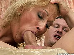 Sexually aroused woman with saggy tits seduced young stud for sex. Brutish stud goes down on horny woman eating her pussy dry. He stretches her vaginal folds delving his tongue deep inside. Then he face fucks dirty slut.