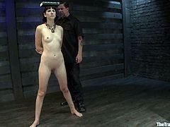 Kinky brunette milf Coral Aorta is having fun with some guy indoors. The man binds and torments the slut and then rubs her snatch with a dildo till she cums.