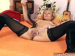This blonde granny is a mistress. She uses her whip to tease her tits and to lightly touch her old cunt. Then, she takes a vibrator and fills up her pussy.