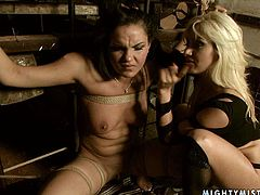 This brunette is the kind of girl that needs to be punsihed hard. She's securely tied to a metal frame by smoking hot mistress. Make sure you don't miss this breathtaking BDSM scene.
