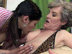 Playful brunette cutie makes out with fuckable grey-haired mature. They suck and lick each other's tits before sizzling brunette goes down to soaking cunt to tongue fuck it zealously.