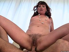 Shabby looking brunette mature gives a cowgirl ride to her young sex hungry lover before she turns around to keep hoping on him reverse with her bearded vagina.