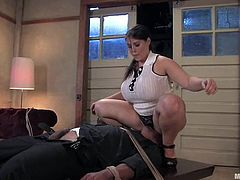 Brunette chick with huge boobs and ass sits on guy's face. After that she whips him and toys rough with a strap-on.