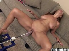 Samantha prepares her sex machine, she lubes the dildo strapped on it and sucks it before putting it between her big, round boobs. The slut takes this as it is a training and prepares herself for those long, hard fucks. She then takes a sit on the couch, spreads her thighs and receives that dildo deep in her pussy