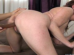 Two sex hungry MILF lesbians please each other using a long dildo. Sizzling blondie stands in doggy position while a foxy brunette pokes her snatch with a dildo before they switch the roles in peppering lesbian sex video by 21 Sextury.