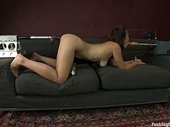 Sexy brunette chick has some fun in her house after work. She lie on a sofa on all fours. She sucks big dildo and gets her pussy drilled from behind.