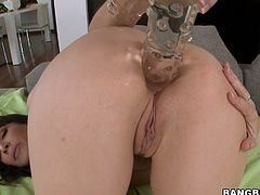 Sexy horny brunette Dana De Armond stuffs her ass with a hook and then pounds it with a massive dildo. Then she allows some guy to drive his prick into her brown cave and enjoys ardent anal sex in the reverse cowgirl position.
