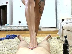 Skillful bootylicious sexy Carmen with many provocative tattoos and natural tits gets naked while teasing turned on lover with meaty cock and gives him memorable foot job in pov.