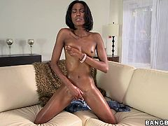 It's a solo masturbation video by the ebony babe Adriana Malao who plays with her delightful shaved pussy that ends up soaked in fluids.