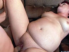 Oversized red-haired mature BBW widens her legs to allow a kinky dude tongue fuck her puffy shaved pussy before he pokes it missionary style.