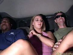 Slutty blond haired girlie with natural tits wears light pink dress. This long legged nympho sits between two men on the back seat of the limo and rubs her wet pussy madly for orgasm.