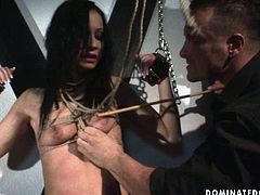 Arousing brunette hottie Sonia gets crucified by pitiless master who pins her naked body with pegs and later tickles her cunt with vibrator. Later he forces her to give him a head in BDSM-styled sex video by 21 Sextury.
