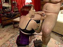 Lewd dark-haired milf Mz Berlin is having funw ith Wolf Hudson and one more dude indoors. She makes the dudes suck each other's cocks and then fucks their butts with a strapon.