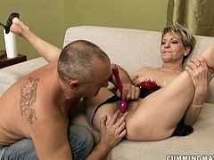 This kinky dad is a master of pleasing sex hungry moms. One of them lies in front of him with legs wide open in playful lingerie while he stretches her bearded cunt and later stimulates it with sex toys.