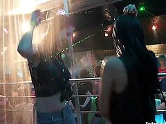 Sinfully lesbian cuties dancing and masturbating their slick beavers in public in a club