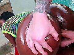 Ebony ass is the best, especially when it is all oiled up, and the sun is making it shine. Staring Layton Benton. Outdoors hardcore action as this beautiful babe with amzing tits bends over and takes a long hard cock deep into her.