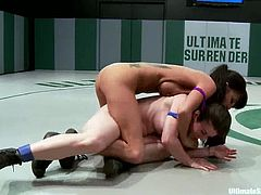 Gia Dimarco and Serena Blair try to find out who is the better wrestler. Gia loses the battle, so she gets fucked with strap-ons by the winning girl and a referee.