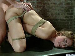 Kara Price allows Mark Davis to restrain her in a basement. Mark stuffs Kara'a ass with a hook, and then chokes the bitch while fucking her in missionary position.