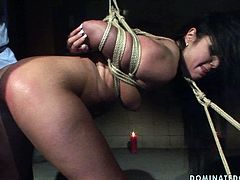 Nasty brunette wench is into hardcore BDSM sex games. So she is tied up in doggy position. The guy face fucks her at first. Then he bangs her cunt from behind.