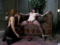 Stunning Vivienne Del Rio gets undressed and tied up by her sexy mistress. Later on she gets her tits tortured with metal claws and pussy toyed with a strap-on.