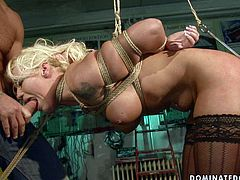 Ample busty blond whore bends down bandaged wearing lacy black stockings while a perverse dude nails her soaking twat from behind in steamy BDSM sex scene by 21 Sextury.