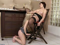 Appealing blonde chick is going naughty with horny old woman. She suckles saggy boobs and then she goes down eating wet sticky cunt.