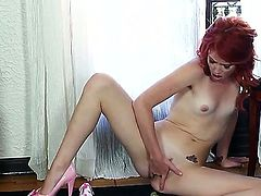 Slender redhead beauty Elle Alexandra gets butt naked and goes to work on her pink taco while displaying her delicate little tits and kinky pink heels.