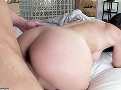 Voracious brunette amateur with oversized round tits stands in doggy pose getting her unused cunt pounded with long hard dick before she rides it in cowgirl style.