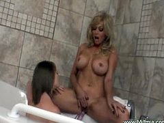 Lesbian girls are horny and toying in the bathroom.