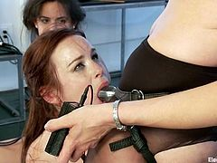 Two submissive girls get toyed and wired by two mistresses