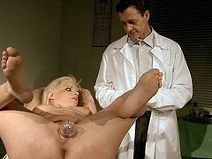 This shameless blondie is securely bound to the operating table. Horny doctor clamps clothespins on his patient's luscious tits. Check out this BDSM sex scene now and get ready to cum.