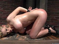 Bosomy red-haired sex bomb with hands cuffed stands on her knees in front of aroused fucker to give him a deepthroat blowjob before she bends down to get fucked up from behind in doggy position.