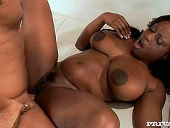 Salacious ebony slut Jada Fire is having a good time with a horny man. She lets him play with her poontang and then welcomes his prick in her black coochie and wet butt.