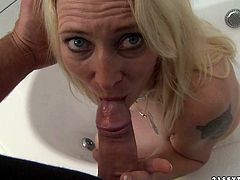 This woman is an experienced slut when it comes to pleasing men. She takes that juicy meat stick in her mouth and sucks it greedily like a dirty whore. Then he fingers her wet snatch.