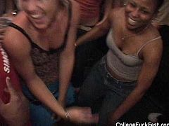 Two aroused lesbians dildo fuck each other's moist pussies during insane party