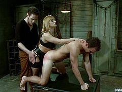 Stunning blonde mistress in whips the guy and ties him up. Later on she toys the guy with a strap-on while the other man fucks her from behind.