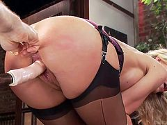 Simone bends over and has a big dildo strapped on a stick shoved up her cunt by Mr. Pete. She gets whipped hard and begs for the pain to stop. The master agrees he'll stop whipping her if she sucks his friend's big dick.