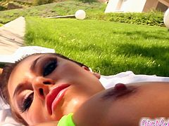 Gianna Michaels poses in her bikini before she goes ahead and masturbates with a huge cucumber outdoors.
