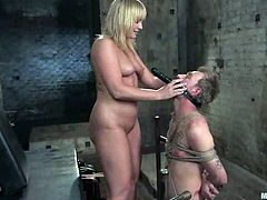 Busty blonde chick in latex gets her vagina licked by her sex slave. After that she also drills his ass with a strap-on. Then he toys her pussy with a dildo fixed to his head.
